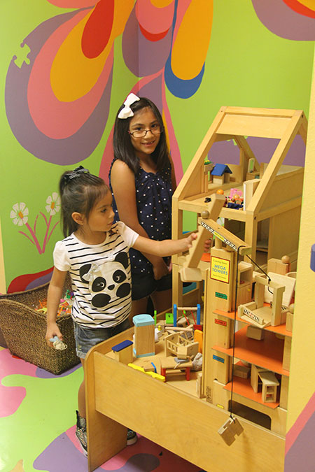 Kids playing with doll house - Pediatric Dentist in Newbury Park, CA