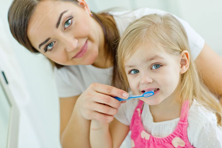 Mom and Daughter brushing their teeth - Pediatric Dentist in Newbury Park, CA